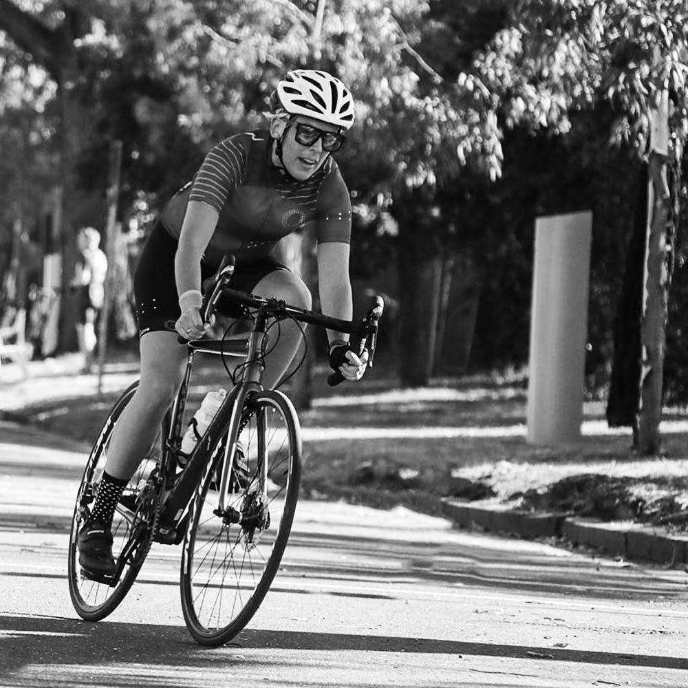 Cyclist cornering in a bike race