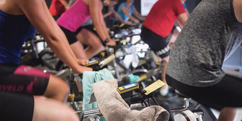 Group of people doing Cycle Collective class